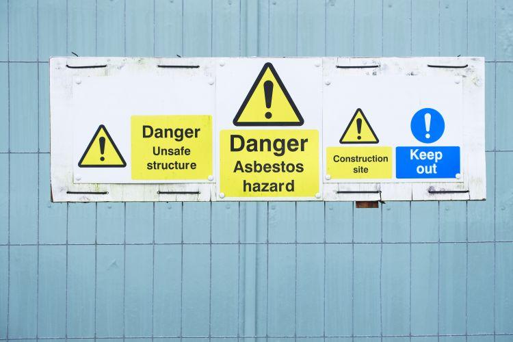 Asbestos hazard sign outside construction site