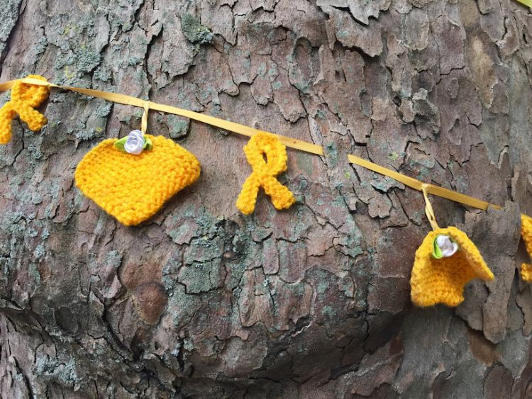 Yellow tributes tied to a tree near Grenfell tower disaster