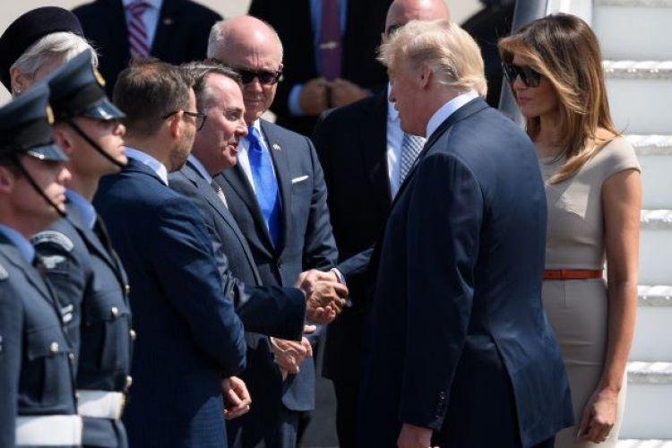 Secretary of State for International Trade Liam Fox (L) greets U.S. President Donald Trump following the President's arrival at Stansted Airport on July 12, 2018 in Essex, England