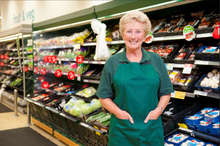 Image of mature female shop worker