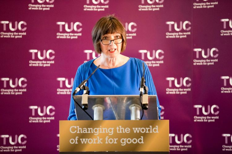 Frances O'Grady speaking at a TUC 150 Congress lecturn