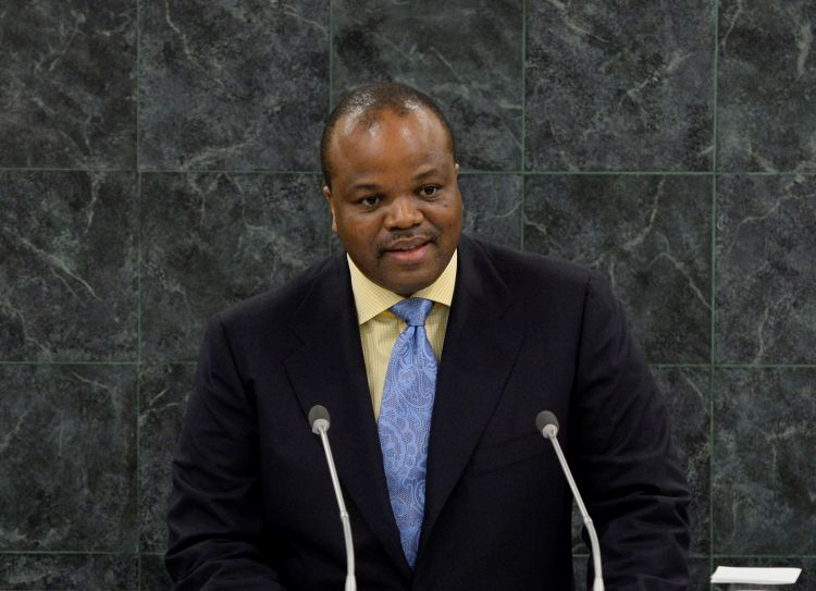 Photo of King Mswati III speaking at a lecturn