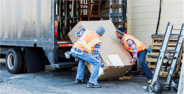 Two workers loading truck