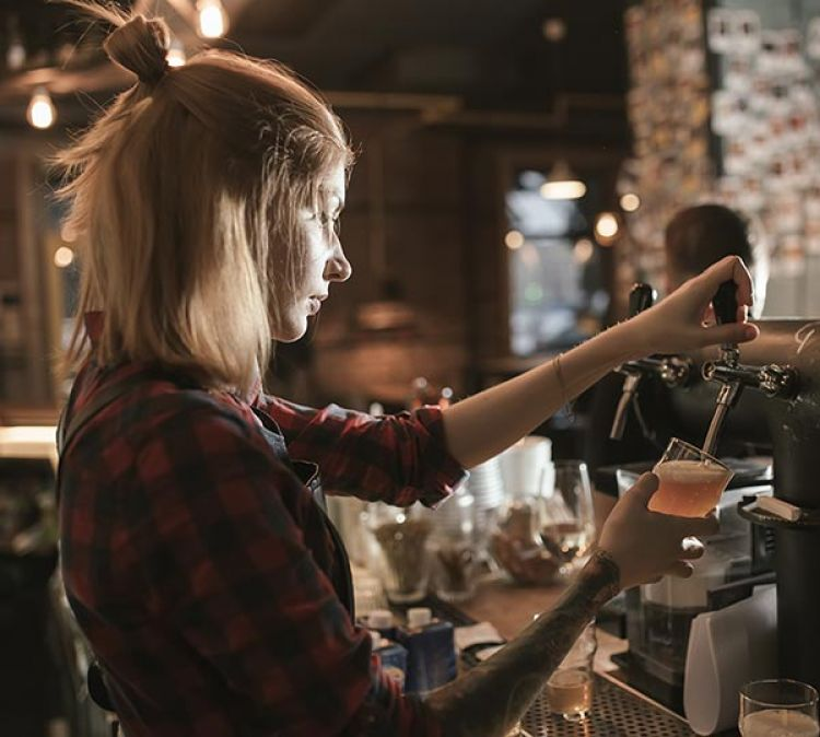 Bar worker at night. Photo: AntGor