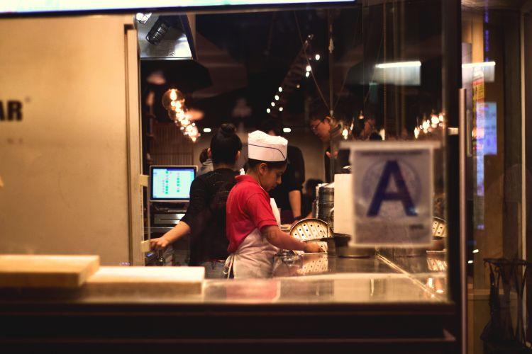 A kitchen worker prepares food