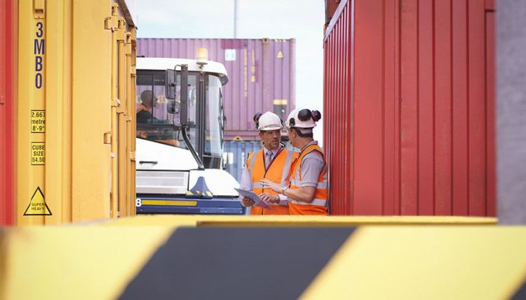 Workers at container port. Photo: Monty Rakusen