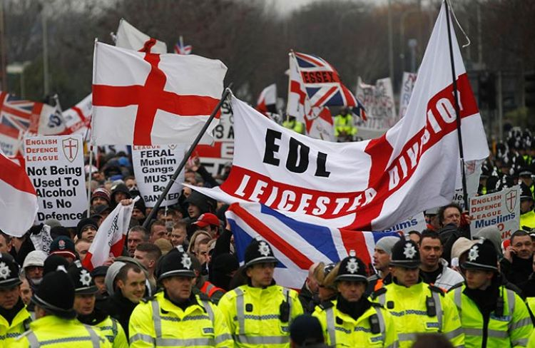 Far-right demonstrators with flags.