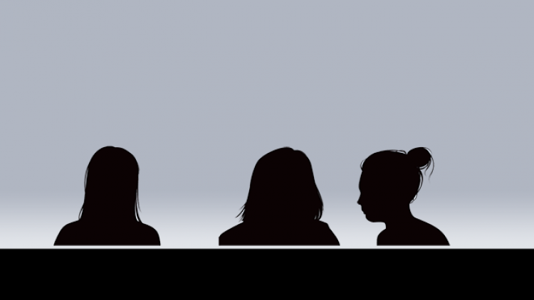 Silhouette of three women sitting in front of a grey background