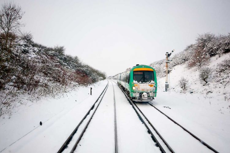 A train travelling through the snow on a winter's day